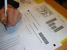 hand writing on answer sheet